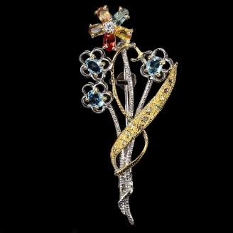 Брошь. Натуральный голубой топаз, сапфир и танзанит. Серебро 925.